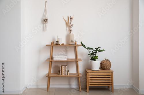 Obraz Interior of modern room with shelf unit and decor - fototapety do salonu