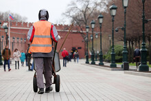 Worker Carries A Wheelbarrow In The Moscow. Street Cleaning And Sidewalk Repairing In Spring City