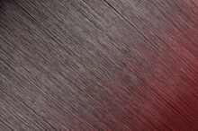 Closeup Of Single Piece Of Clip In Straight Black To Red Highlights Ombre Style Synthetic Hair Extensions
