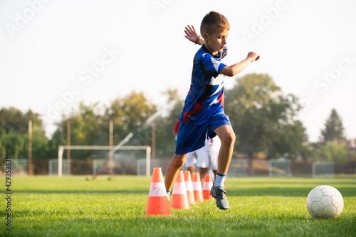 Naklejka premium Boy Soccer Player In Training.