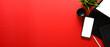 Leinwandbild Motiv Overhead shot of bright red desk with office supplies and mock up smartphone