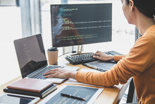 Young Professional Programmer Working At Developing Programming And Website Working In A Software Develop Company Office, Writing Codes And Typing Data Code, Programming With HTML, PHP And Javascript