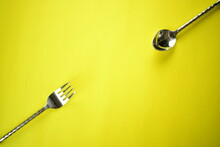 Sliver Wares Spoon And Fork On Bright Background