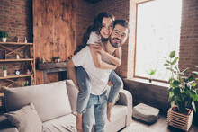 Portrait Of Attractive Careful Funny Cheerful Couple Having Fun Piggy Backing Spending Holiday At Loft Style Interior Home House Indoor