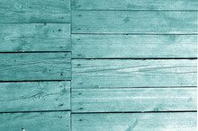 Wall Made Of Uncutted Weathered Wood Boards In Cyan Tone.