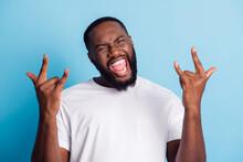 Photo Of Rocker African Man Hands Show Horn Gesture Scream Wear White T-shirt Over Blue Background