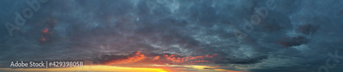 Beautiful cloud in the sunrise sky background. Sky banners background. Natural background of the colorful panorama sky. - fototapety na wymiar