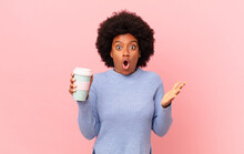 Afro Woman Feeling Extremely Shocked And Surprised, Anxious And Panicking, With A Stressed And Horrified Look. Coffee Concept