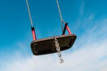 Empty  Swing Flies Free In The Blue Sky