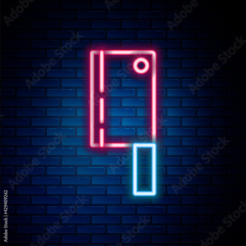 Slika na platnu Glowing neon line Meat chopper icon isolated on brick wall background