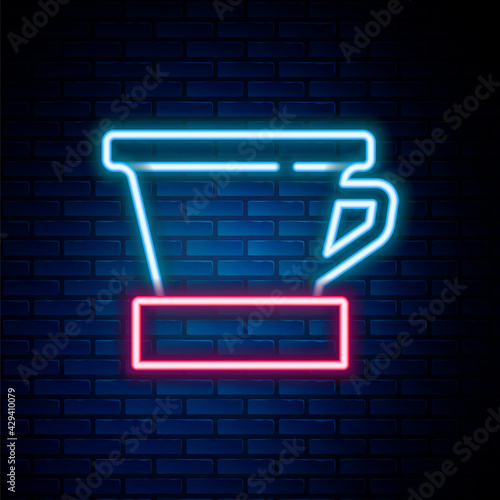 Obraz na plátně Glowing neon line V60 coffee maker icon isolated on brick wall background