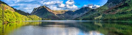 Obraz na plátne Buttermere lake overlooking Haystacks peak in Lake District
