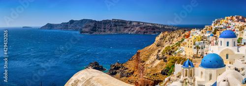Fototapeta Scenic pnorama of Blue domes in Oia village. Santorini island. Greece obraz