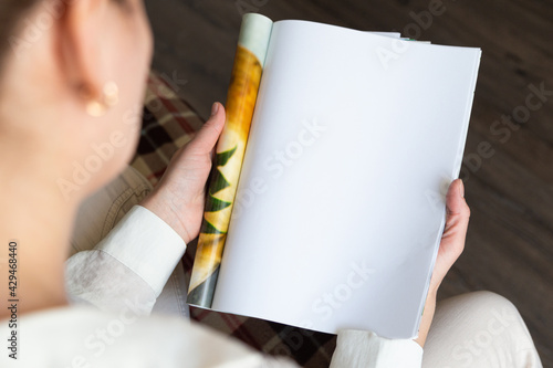 Female hands open blank catalog, magazines, book mock up - fototapety na wymiar