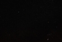 Night Sky With Many Stars In Area Near Constellation Monoceros And Canis Minor, Bright Procyon Star Visible In Centre, Orion Nebula At Bottom Right Corner