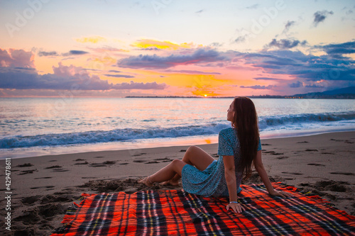 Fotografie, Tablou Woman on the beach enjoying summer holidays looking at the sea