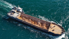 Aerial Drone Photo Of Assisted With Tug Boat Barge Filled With Stones Near Mediterranean Port