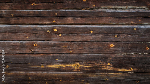 Obraz na plátně brown grunge background from old log wall of rustic hut for creative backdrops,