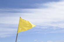 Yellow Flag On Blue Sky