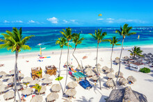 Beach Vacation. Aerial Drone View Of Tropical White Sandy Bavaro Beach In Punta Cana, Dominican Republic. Amazing Landscape With Palms, Umbrellas And Turquoise Water Of Atlantic Ocean