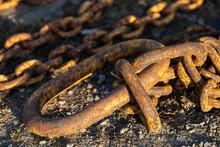 A Rusty Chain On The Beach