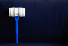 Plastic Hammer In Blue Background. A Tradition Of The Night Of Saint John In Portugal. (Martelinho De S. João)