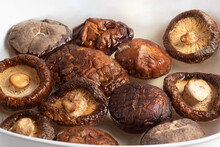 Dried Shiitake Mushrooms Soaking In Water.