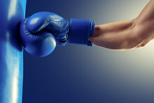 Strong Boxer Hand In A Blue Boxing Glove.