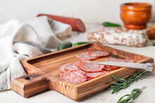 Board With Slices Of Salami On Table