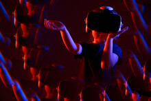 Young Child Girl Using VR Headset Helmet To Watch Virtual Reality 3d 360 Video