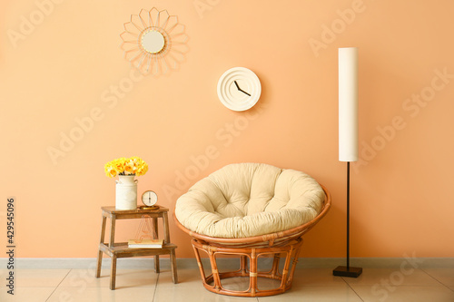 Fotografie, Obraz Stylish interior of living room with armchair and narcissus flowers