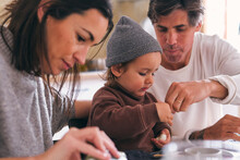Crop Parents With Charming Daughter During Breakfast At Home