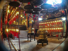 Chinese Asian Buddhism Temple Interiors With Buddhistic Statues, Shrines, Pagodas, Altar Offerings And Burning Incenses In Red And Gold Decoration Religious Spiritual Surrounding