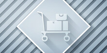 Paper Cut Hand Truck And Boxes Icon Isolated On Grey Background. Dolly Symbol. Paper Art Style. Vector