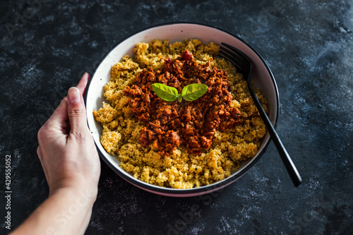 vegan bolognaise couscous with plant-based mince sauce, healthy plant-based food