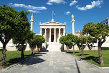 Beautiful Neoclassic Academy Of Athens Public Landmark Building With Beautiful Spring Clouds And Deep Blue Sky, Athens Historic Centre, Attica, Greece