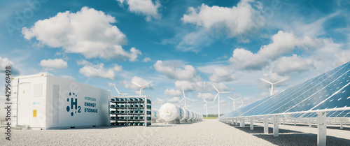 Fototapeta Modern hydrogen energy storage system accompaind by large solar power plant and wind turbine park in sunny summer afteroon light with blue sky and scattered clouds. 3d rendering. obraz