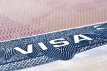 U.S.  VISA United States Of America. American Tourist Or Green Card Visa On Passport Background.