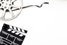 Cinema Background With Movie Clapperboard And Film Reel