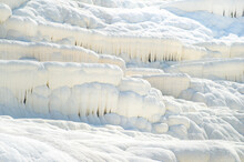 Natural Carbonate Formations On A Mountain In Pamukkale, Turkey