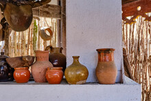 Old Caucasian Pottery On A Whitewashed Oven In The Yard.
