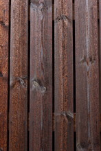 Texture Of Vintage Style Barn Wall Made From Homemade Rough Sawn Timber. Knotty Boards Treated With Varnish And Pine Tar.