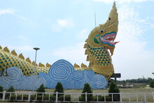 YASOTHON, THAILAND , Statue Of Phaya Kan Kark (The Toad King) In Yasothon, Thailand. Landmark Building Constructed In Shape Of Naga (serpent)