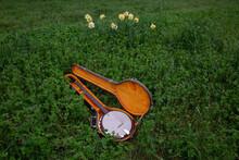 Banjo In Open Case In Meadow