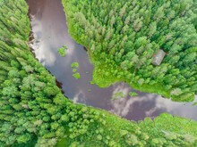 Aerial View Of Svir River Crossing A Pine Forest Trees Near The City Of Podporozhskoe, Leningrad, Russia.