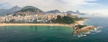Panoramic Aerial View Of Ipanema And Arpoador Rock With Christ The Redeemer And Sugarloaf Mountain In Distance, Rio De Janeiro, Brazil.