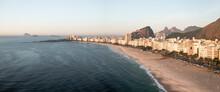 Panoramic Aerial View Of Copacabana Beachfront At Sunrise With Mountain Rage In Background, Rio De Janeiro, Brazil.