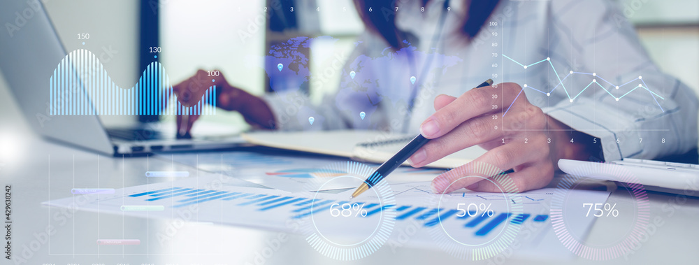 Fototapeta Financial Businesswomen analyze the graph of the company's performance to create profits and growth, Market research reports and income statistics, Financial and Accounting concept.