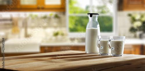 Fototapeta Fresh cold milk in kitchen and window background  obraz