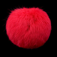 Close Up Of Red Rabbit Fur Pompom Isolated On Black Background